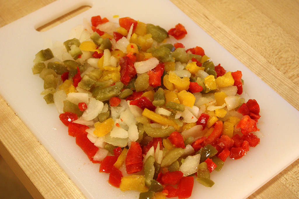 Thawing and chopping the peppers and onions